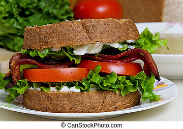 BLT Sandwich with soup - A BLT sandwich and a bowl of split...
