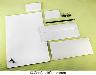 Corporate identity set on green background Blank stationery...