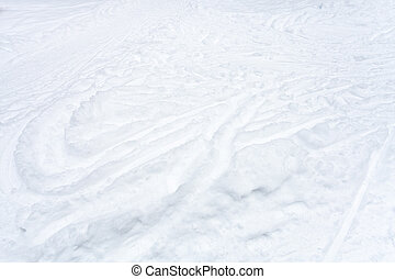 snowfield with ski runs and paths in snow in winter day