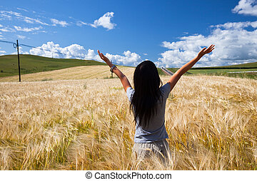 girl - the girl stand in the wheaten field.