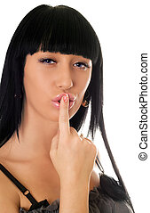 Young woman with a finger at lips