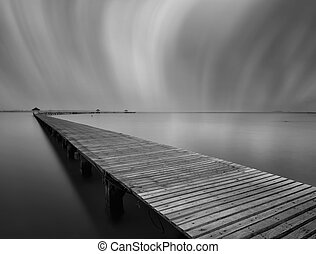 The long bridge over the sea in black and white,Thailand