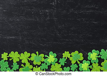 Green Clover on Chalkboard Background Background for St....
