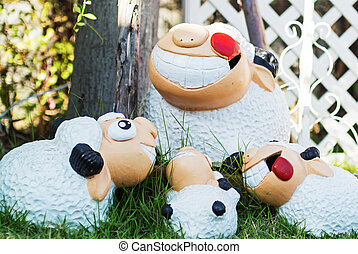 Family sheep doll on the meadow