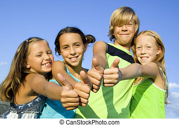 Four young positive kids - Four young beautiful kids showing...
