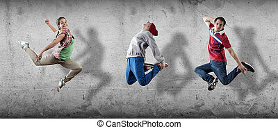 Hip hop dancers - Group of dancer in jump on cement...