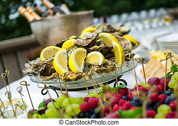 Oysters on ice at buffet table, catering - seafood cold...