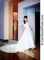 Beautiful bride in a luxurious interior
