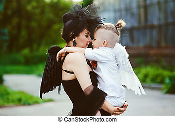 Mom with son playing good and evil