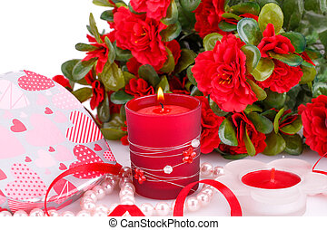 Valentines day - Red flowers, candles and gift box close up...