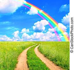 Rural landscape with old road and rainbow