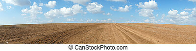 Plowed land - Panorama of plowed land in rural area of...