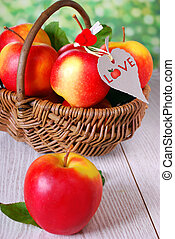 I love apples - wicker basket full of red apples with...