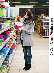 Woman Shopping For Bowl In Produce Department