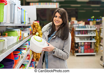 Beautiful Young Woman Shopping In A Grocery Supermarket -...