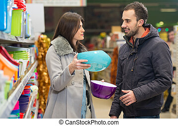 Couple Shopping At The Supermarket - Beautiful Young Couple...