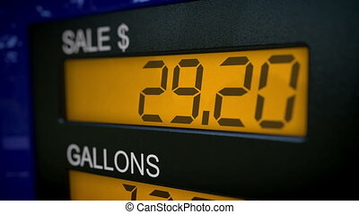 Gas pump time lapse - Zoom in on gas pump display with fast...