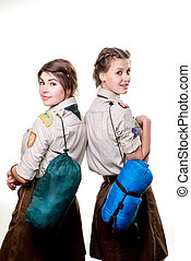 Scouts in studio - Two young scout girls with sleeping bags...
