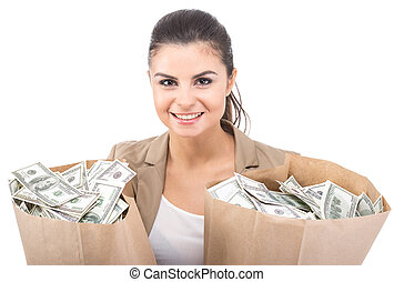 Money - Young smiling woman with paper bags full of money,...