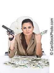 Money - A young business woman at the table with a lot of...