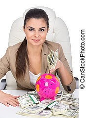 Money - Young business woman at the table with a lot of...