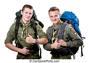 Scouts in studio - Two young scout boys with sleeping bag...