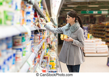 Woman At Groceries Store - Beautiful Young Woman Shopping...
