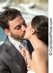 Bride pulls the tie of the groom while kissing him - Married...