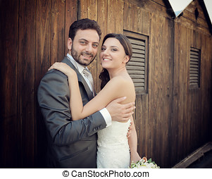 Married couple near wooden cabins - Married couple in day of...
