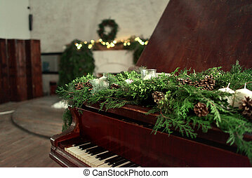 Christmas piano - against the background of the fireplace...