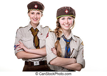 Scouts in studio - Two young scout girls standing together...