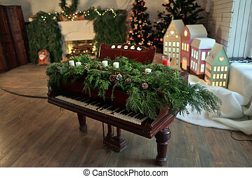 Christmas piano - a room with a fireplace and Christmas...
