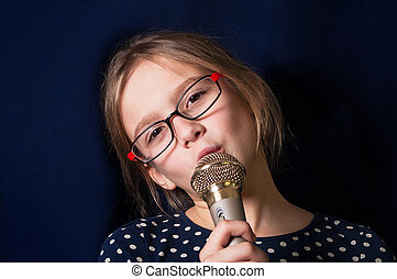 Girl Singing - Portrait of a cute girl of ten making face...