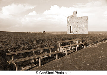 sepia benches and path to Ballybunion castle