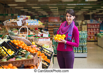 Young Woman Shopping In The Supermarket - Beautiful Young...