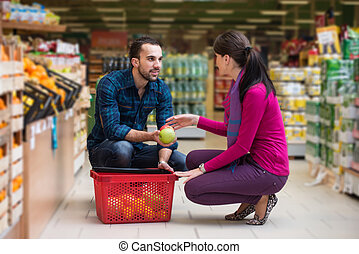 Couple Shopping In Supermarket - Beautiful Young Couple...
