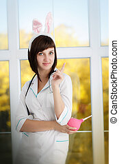 Sexy attractive nurse in a dressing gown with ears of...