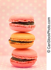 Traditional french colorful macaroons on pink retro...