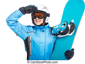 Winter sport - Young smiling woman is posing with snowboard...