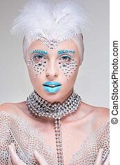 portrait of beautiful girl with diamonds blue lips art
