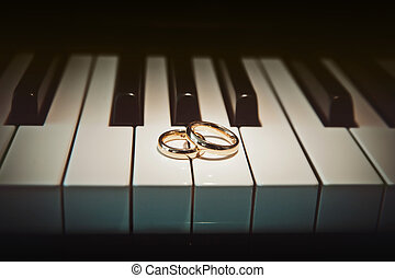Wedding rings on piano