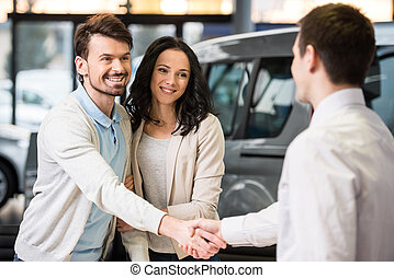 Car sales - Young couple grateful sales manager for advice...