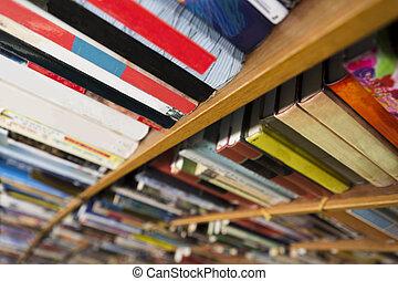 books in book shelf - close up of books in book shelf in...