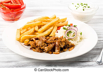 Kebab plate with french fries