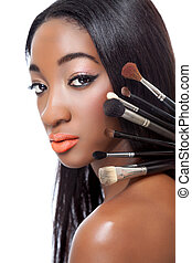 Black woman with straight hair and makeup brushes isolated...