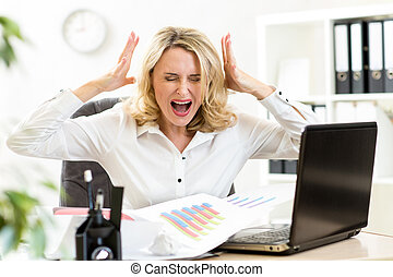 Stressed business woman screaming loudly working in office -...