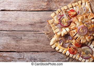 Puff pastry pies with red onions and tomatoes Horizontal top...
