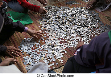 Counting coins - Counting coins from to make a donation