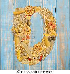 Letter D made from pasta on a blue wooden  background