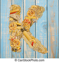 Letter K made from pasta on a blue wooden background
